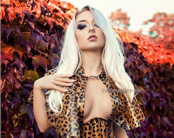 An Autumn Affaire: Photo print of model Lotte LaVey in latex leopard print outfit with Autumn leaves