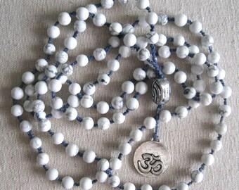 "Mala. White turquoise (howlite), 108 6mm beads, Om amulet, 44"" long."
