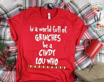 7d5eb828 In A World Full Of Grinches Be A Cindy Lou Who Shirt. Christmas Shirt.  Funny Holiday Tee. Cindy Lou Who Shirt. Grinch Shirt. Funny Christmas