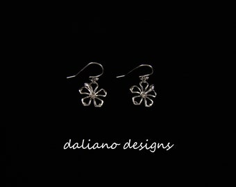 Hibiscus Hook Earrings. Hawaiian & Island inspired jewelry designs. 925 Sterling Silver w/ Rhodium plating to prevent tarnish.