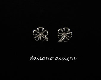 Hibiscus Post Earrings. Hawaiian & Island inspired jewelry designs. 925 Sterling Silver w/ Rhodium plating to prevent tarnish.