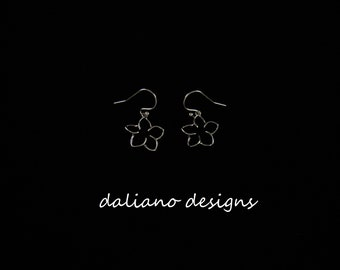 Plumeria Hook Earrings. Hawaiian & Island inspired jewelry designs. 925 Sterling Silver w/ Rhodium plating to prevent tarnish.