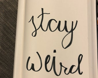 Stay weird calligraphy