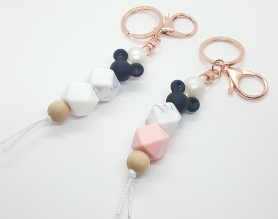 Disney family silicone beaded keychains. Features mouse ears and a gray marbled bead with a choice of black, beige, blue, white, or pink.