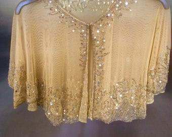 Beige coloured beaded embellished cape