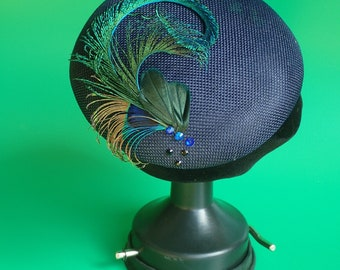 Navy Blue fascinator light sinamay. Peacock feathers and pheasant. Blue and black rhinestones. 15cm in diameter.