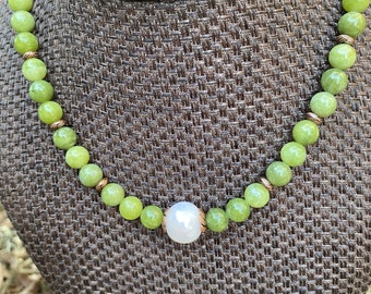 Peridot Jade beads with a large fresh water pearl as a focal and copper accents.