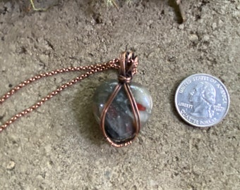 Heart shaped Bloodstone pendant wire wrapped with copper wires, chain included.