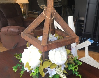 Tobacco stick lantern with white cabbage roses