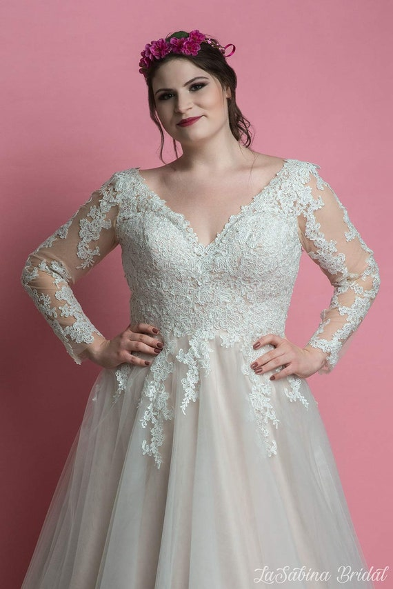 1940s Style Wedding Dresses | Classic Wedding Dresses Plus size wedding dress long sleeves plus size wedding dress lace wedding dress $534.70 AT vintagedancer.com