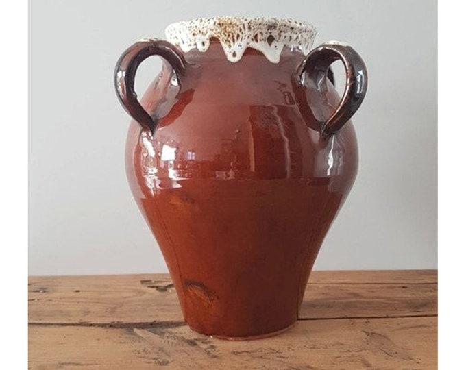 Brown varnished pot