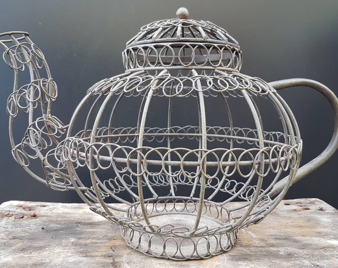 Metal wired teapot