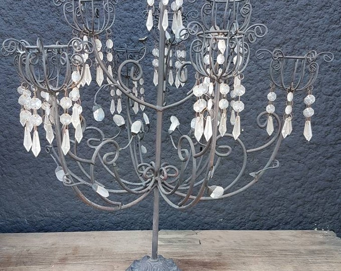 Chandelier carries candles