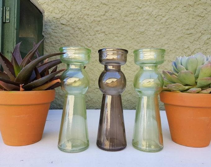 Trio glass candlesticks