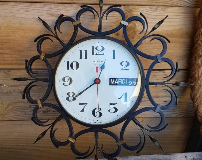 Vintage calendar metal clock