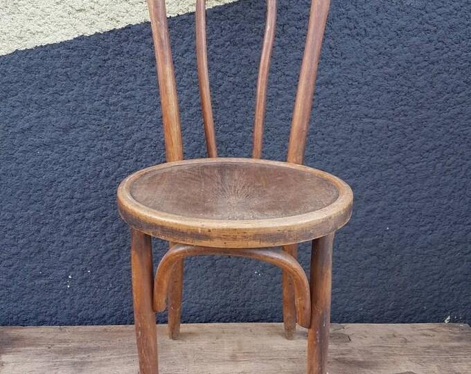 Curved wood baumann chair