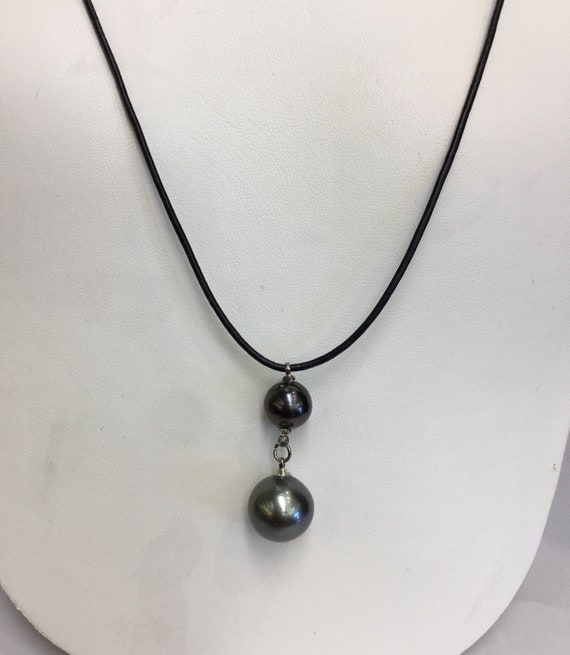 14mm Tahitian South Sea Pearl Pendant  Leather Cord  Adjustable Length hanging from 10mm Tahitian Pearls