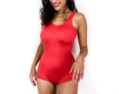 80s vintage swimsuit with a totally 1960s vibe. Bright red with thick straps. Light shine. Super sexy. Open back.