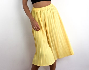 ea99230d0c7a Vintage 70s/80s bright yellow pleated midi skirt. Light and comfortable.  Beautiful movement in the fabric. Best suits sizes S to L