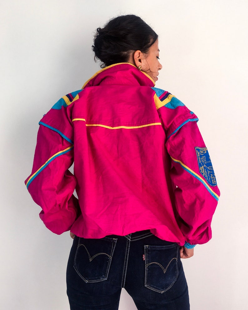 80s vintage windbreakerjacket very old school Hot pinkfuchsia and multicoloured Large fit Awesome shoulders and double collar.