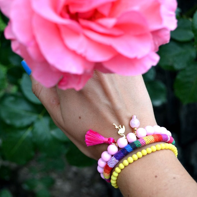A set of 3 colourful bracelet with flamingo charm and tassel