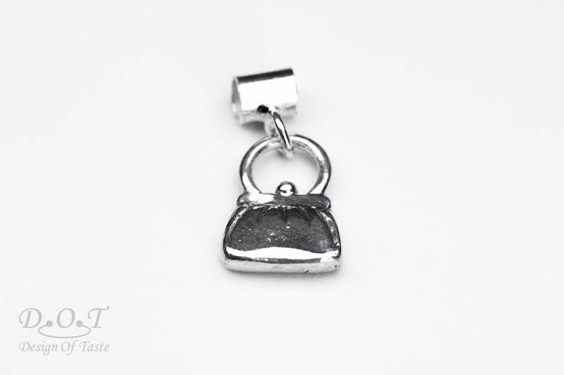 Sterling silver purse charm bracelet