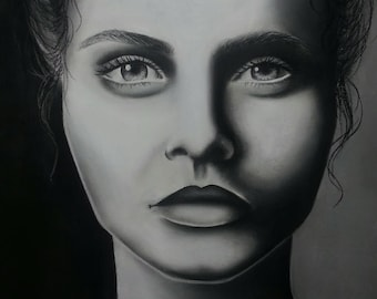 A2 charcoal drawing of Cara Delevingne