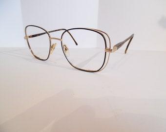 d924e207e3d Vintage Womens REVLON 1004 Eyeglasses Designer Gold Used Frame