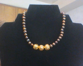 Chocolate freshwater pearls, gold filigree accents.