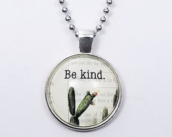 Glass cabochon pendant; silver bezel with ball chain ; be kind