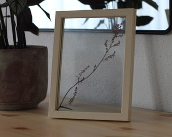 Pressed flower in see through frame