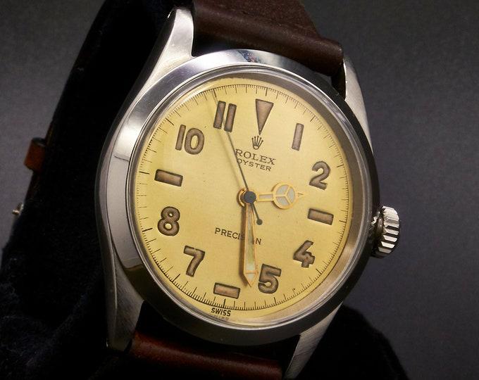 "RARE! 1953 Rolex Oyster Royal 6282 Men's / Unisex Round Tonneau Watch • Metallic Gold Dial • Sunken Arabic, ""Dash"" and Triangle Markers"