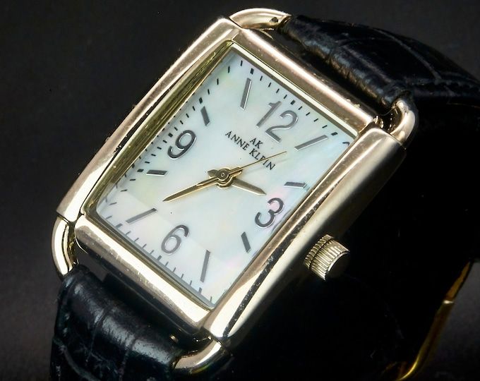 1990s Anne Klein 10/9359 Stainless Steel Tank Watch • Mother of Pearl Dial • Black Leather Toscana Quick Release Band • Late Century Jewelry