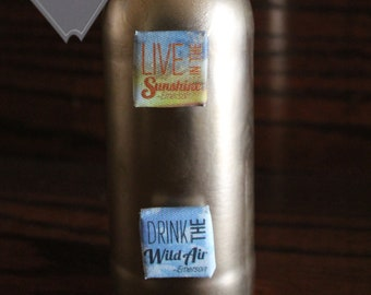 Message on Bottle Live in the sunshine; Drink the wild air (canvas)