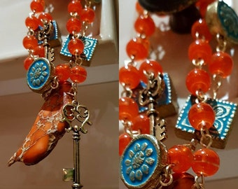 Vintage vibe bracelets. Key charm. Happy colors
