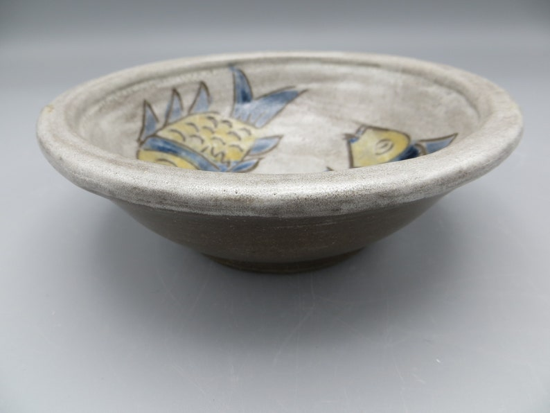 Handmade pottery bowl with Japanese Fish Design