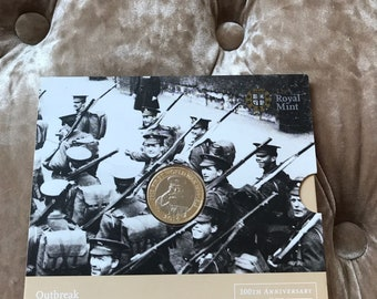 50p coin OUTBREAK 2014 10th ANNIVERSARY of the first war
