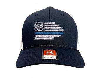 Bravest   Finest Blue Lives Matter Tattered Flag Navy Trucker Hat 882bdc3668b