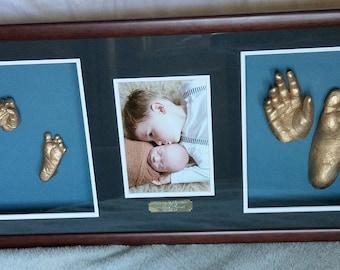 1 Hand 1 Foot Framed Sibling Sculptures