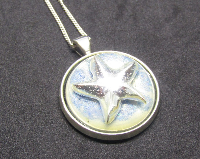 Starfish Resin Pendant necklace. silver starfish on a sparkly seabed with silver chain.