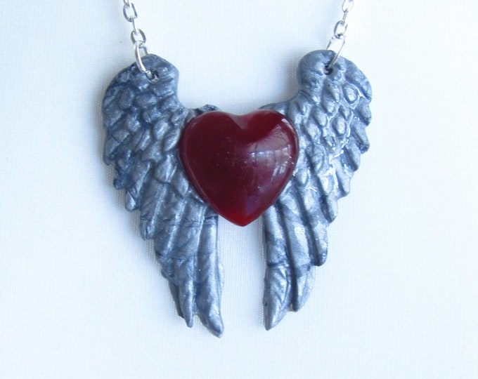 Heart and Angel Wings Pendant Necklace. Red resin heart with silver polymer clay wings.
