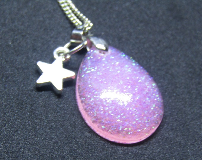 Pretty pink glitter teardrop pendant necklace. With a star charm.