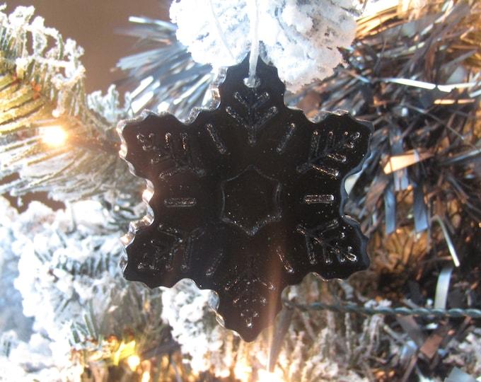 Black snowflake Christmas tree decoration. Large gloss black.