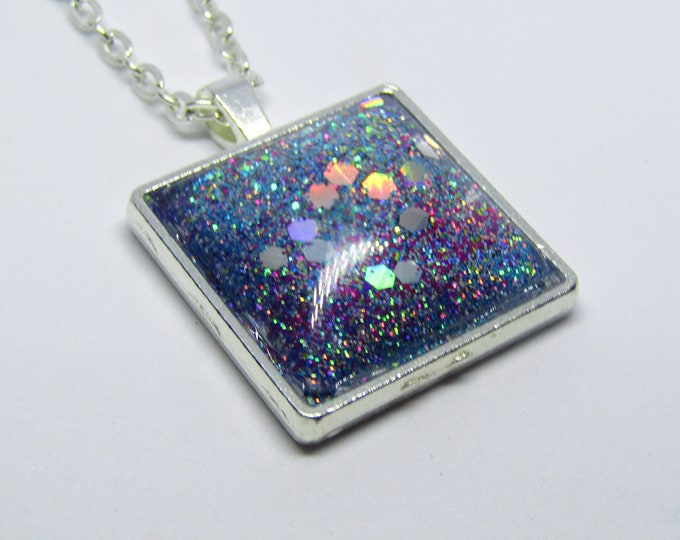 Square Glitter Pendant Necklace. Galaxy and nebula Inspired Pendant on a silver chain.