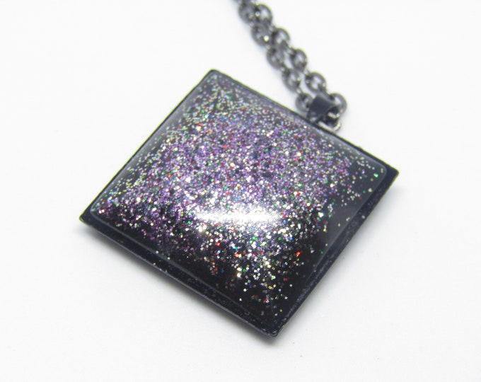 Black, Silver and Purple Square Pendant Necklace. On a black chain.
