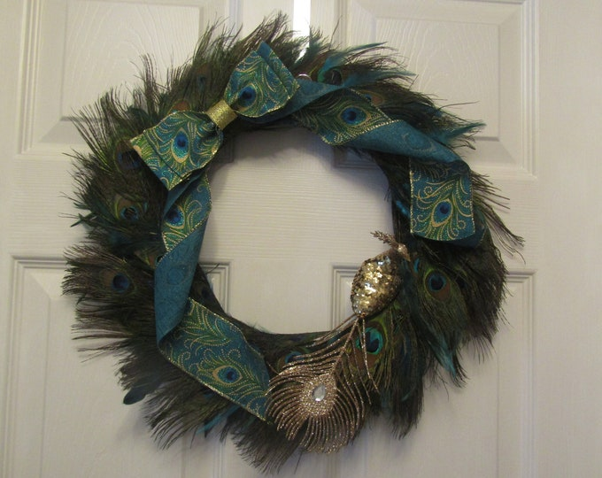 Peacock feather Christmas wreath. Luxury wreath with peacock feather ribbon.