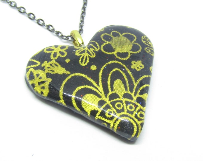 Black and Gold Heart Pendant on a black chain