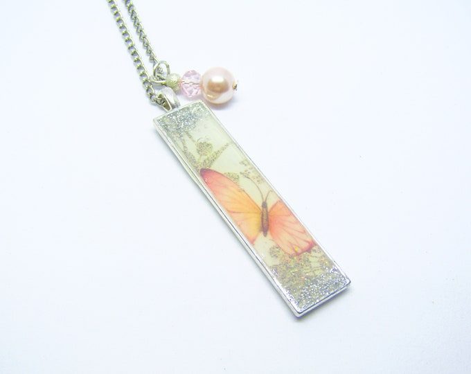 Rectangle Pendant with butterfly paper insert, sealed with resin, and a bead embellishment on a silver plated chain
