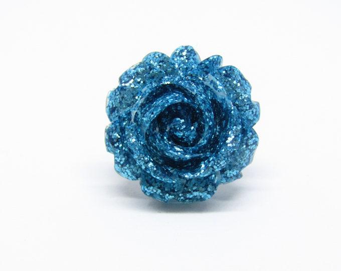 Adjustable rose ring. Turquoise glitter alternative ring.