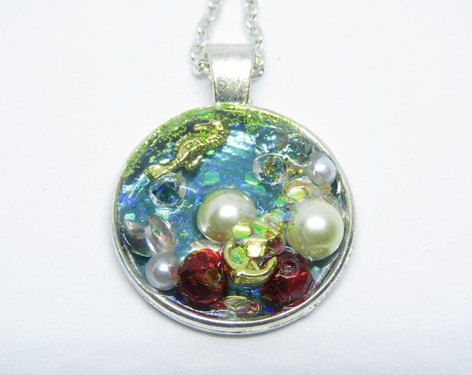 Seahorse, Anchor and treasure resin pendant necklace. Sea-themed treasure Resin Pendant with bead treasure.